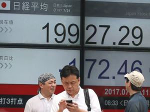 Asian shares mostly lower as