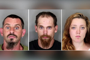 Four arrested for beating,