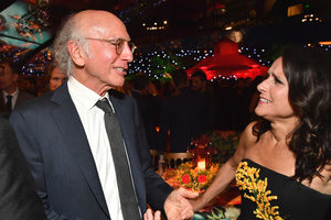 Larry David celebrates at