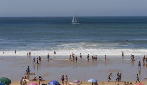Sunbathers Ran Into the Sea to