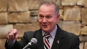 Roy Moore Dings Mitt Romney's