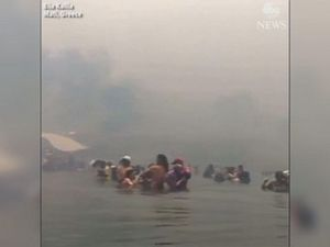 WATCH: People flee into sea to