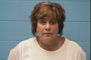 Ex-teacher charged with