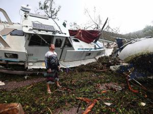 Cyclone rips off roofs, flings