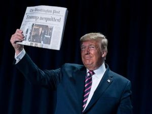 Trump brandishes 'Acquitted'