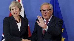 May heading to Brussels amid
