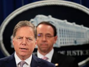 US charges 2 hackers with