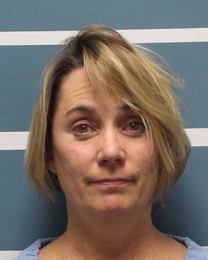 Teacher charged with forcibly