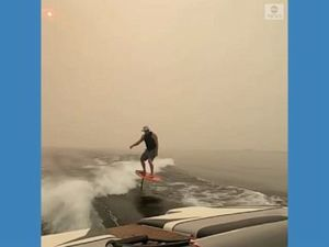 WATCH: Surfer rides on smoky
