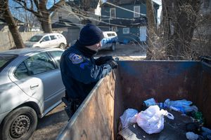 Dog thrown away in dumpster