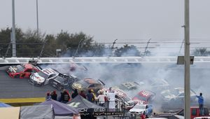 Johnson wins crash-marred,