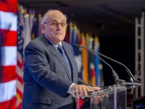 Giuliani threatens legal