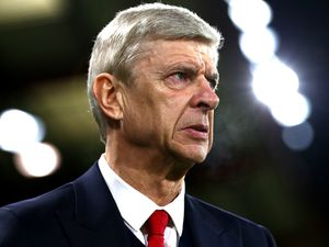 Wenger hints at staying in