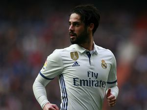 Isco 'happy and committed' at